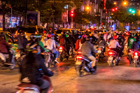 Motor scooters at night in Hanoi