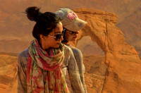 Two Chinese models at Delicate Arch, Utah